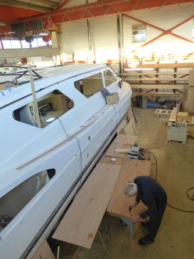 1-Hammering-lugs-into-roofpaneling2