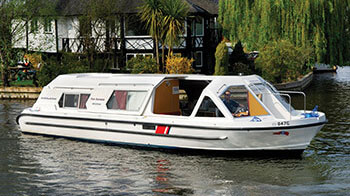 A sporty cruiser being used for a norfolk broads boat hire