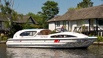 A man renting a boat on the Broads