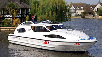 A man enjoying a norfolk broads boat hire